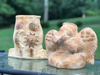 Two brown and white ceramic figurines outdoor decor angel and fish Gainesville, 30501