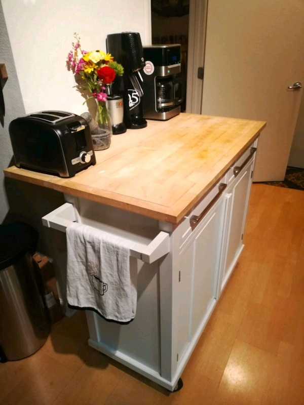 Kitchen island with wooden butcher block top