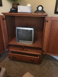 brown wooden TV hutch with gray CRT television San Antonio, 78230