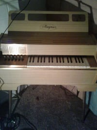 brown and gray Magnus upright piano Glendale, 85301