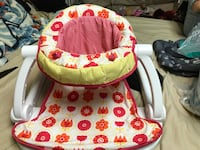 baby's red and white deluxe floor seat