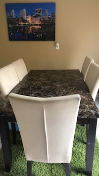 rectangular black wooden table with six chairs dining set Whitby, L1R 1W1