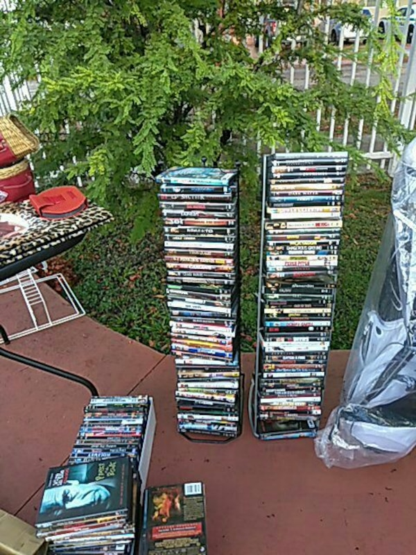 assorted DVD cases and DVD cases