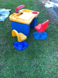 Kids activity desk with two chairs. Gently used. Located in Castleton.
