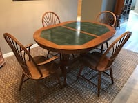 Oval hand made (Amish) wood and tile dining set with 8 chairs and extension that stores under table   Orlando, 32828