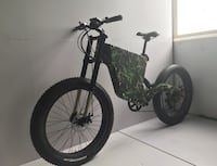 black and green hardtail bike 3739 km
