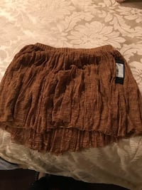 brown and black mini skirt 563 km