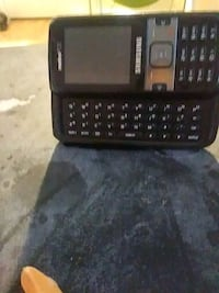 black and gray Samsung slide phone Fresno, 93702