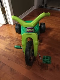 toddler;s green and black TMNT theme trike
