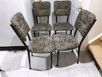 four black-and-gray floral padded chairs $15.00 each. Pickering, L1V 5Z2