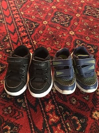 two pairs of black and gray low-top sneakers Calgary, T3J 2X4