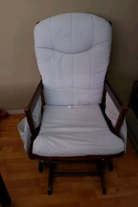 white padded brown wooden rocking chair