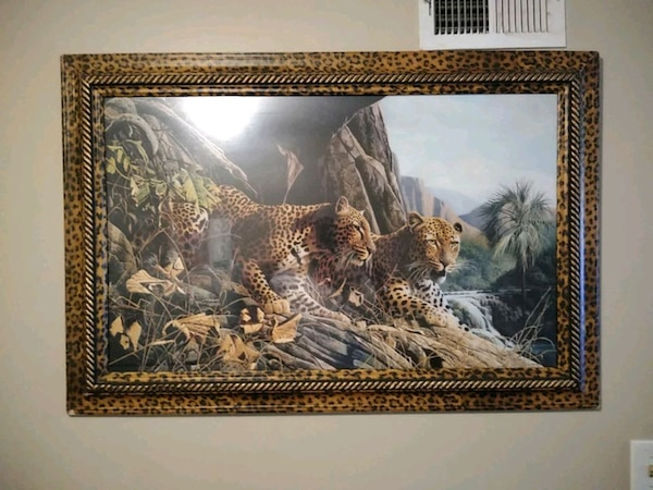 brown wooden framed painting of tiger