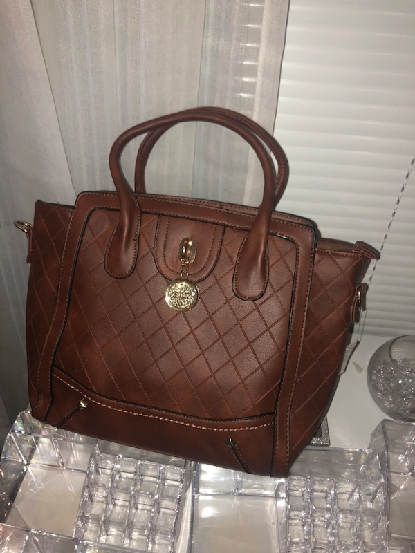 women's quilted brown leather handbag