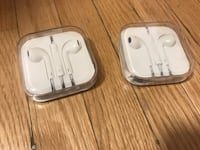 Two Apple EarPods with cases