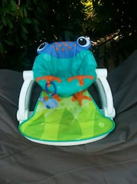 baby's green and blue Fisher-Price bouncer Covington, 98042