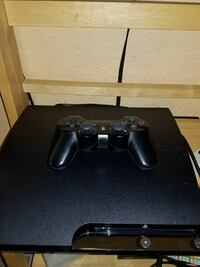 black Sony PS3 slim console with controller Las Vegas
