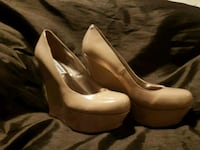 pair of women's brown leather pumps Calgary, T2Z 0K8