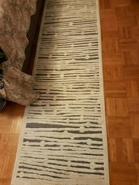 Two rugs for $55.  Toronto, M2M 4B9