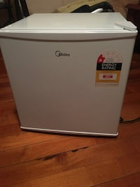 Gray and black haier compact refrigerator null