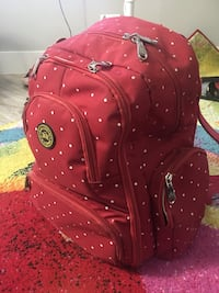 red and white floral backpack SF