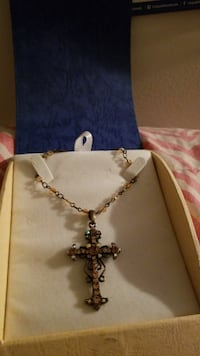 gold-colored necklace with cross pendant and white box Silver Spring, 20910