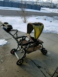 baby's brown and green stroller