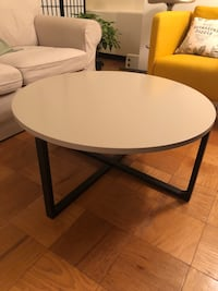 Round white and black wooden table