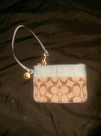 brown and grey Coach wristlet