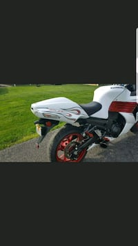 white and black Kawasaki Ninja Sterling, 20165