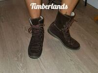 pair of brown leather combat boots 1969 km