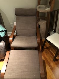 Brown wooden framed gray padded glider chair