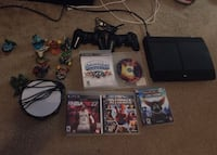 black Sony PS3 console with controller and game cases Washington, 20002