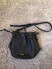 black Guess leather sling bag