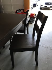 rectangular brown wooden table with four chairs dining set Surrey, V3R 2T5