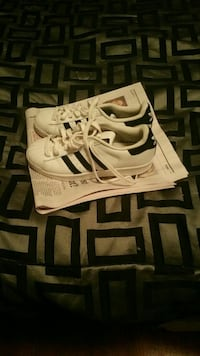 white-and-black Adidas Superstar sneakers size 5