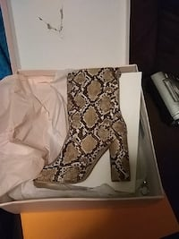 women's brown and black snake heeled boots