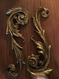 Two gold scrolled wall decor