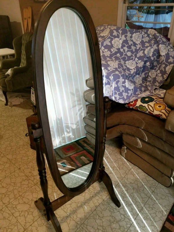brown wooden framed cheval mirror