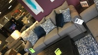 gray fabric sectional sofa with throw pillows Bowmansville, 14026