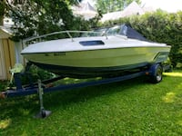 white and blue speed boat Laval, H7X 3K2