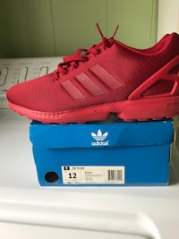 Pair of red adidas low top sneakers on box brand new in box Newport News, 23602