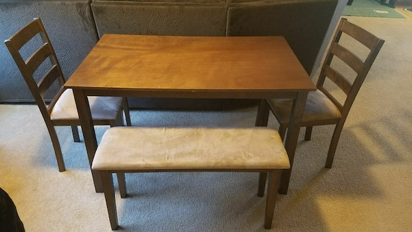 rectangular brown wooden table with two chairs