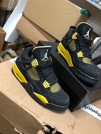 pair of black-and-yellow Air Jordan 4 Centereach, 11720