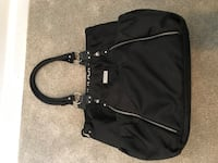 Carter's black diaper bag and changing pad