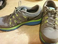 pair of gray-and-green Nike running shoes Georgetown, 40324