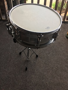 Snare drum with backpack case and stand.  Plays great.  No brand listed on drum