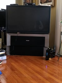 black flat screen TV with black wooden TV stand Redford, 48239