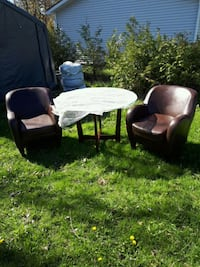 Round  glass  wood base  2 leather chairs not IKEA