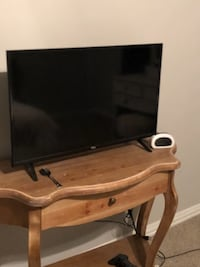 brown wooden TV stand with 32 inch flat screen television DALLAS